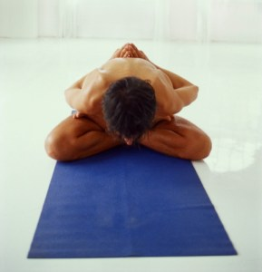 man in yoga position