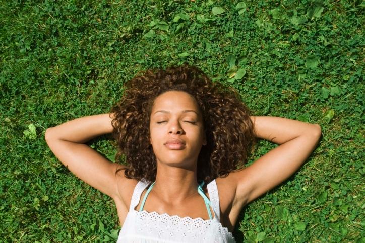 woman relaxing in grass