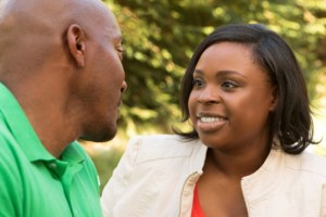 african american couple talking outside
