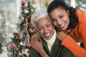 African American Black mother and daughter happy hugging at Christmas