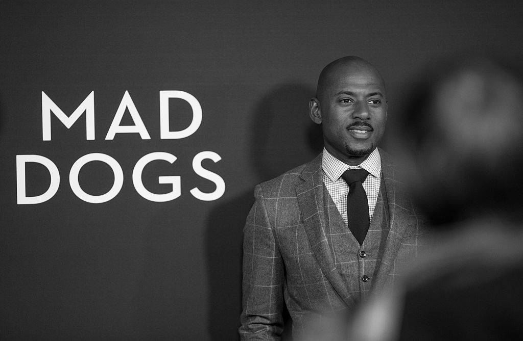 WEST HOLLYWOOD, CA - JANUARY 20:  (EDITORS NOTE: Image captured in black and white, color not avaliable) Actor Romany Malco attends the red carpet premiere screening of Amazon original series 'Mad Dogs' at Pacific Design Center on January 20, 2016 in West Hollywood,