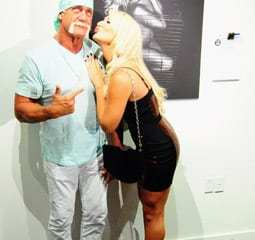 Brooke and Hulk in front of the photo from wireimage.com