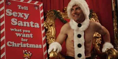"Schmidt (Max Greenfield) ""dressed"" as Sexy Santa for his office party."