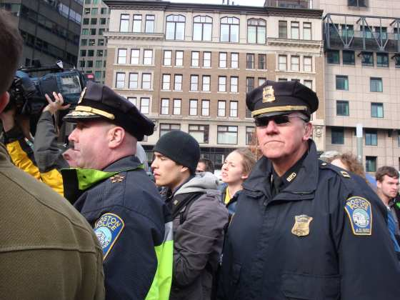 Captain Bernard O&#039;Rourke (right), a frequent presence at Occupy Boston events, displayed stern demeanor on Monday when occupiers attempted to bring a winter-proof tent into Dewey Square.  (Blast Staff photo/John Stephen Dwyer)