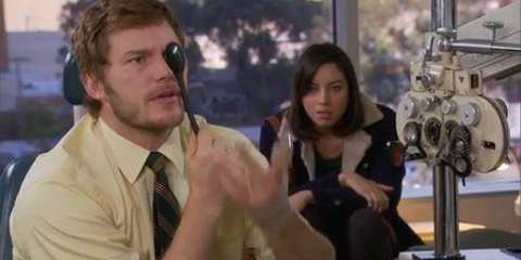 Andy (Chris Pratt) milks his insurance by getting an eye exam. as his wife, April (Aubrey Plaza) looks on mystified.