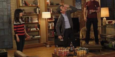 "ssell (Dermot Mulroney) shotguns a beer during a rousing game of ""True American."""
