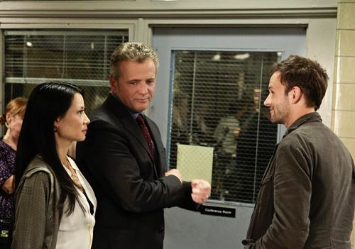 Joan Watson (Lucy Liu), Captain Gregson and Homles discuss their sensitive case.