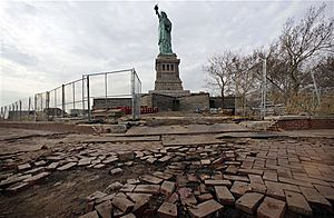 In a Nov. 30, 2012, file photo, parts of the brick walkway of Liberty Island that were damaged in Superstorm Sandy are shown during a tour of New York's Liberty Island. Secretary of the Interior, Ken Salazar, announced on Tuesday, March 19, 2013, that the Statue of Liberty is scheduled to reopen by Independence Day, about eight months after it was closed because of Superstorm Sandy. (AP Photo/Richard Drew)