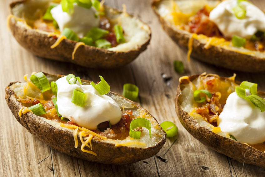 30916567 - homemade potato skins with bacon cheese and sour cream