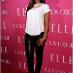 Kelly Rowland wears a blousy white tee shirt on the red carpet.