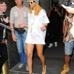 Rihanna wears yet another white tee shirt with nude pumps for a night out.