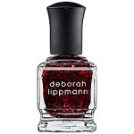Deborah Lippman in  ruby red slippers