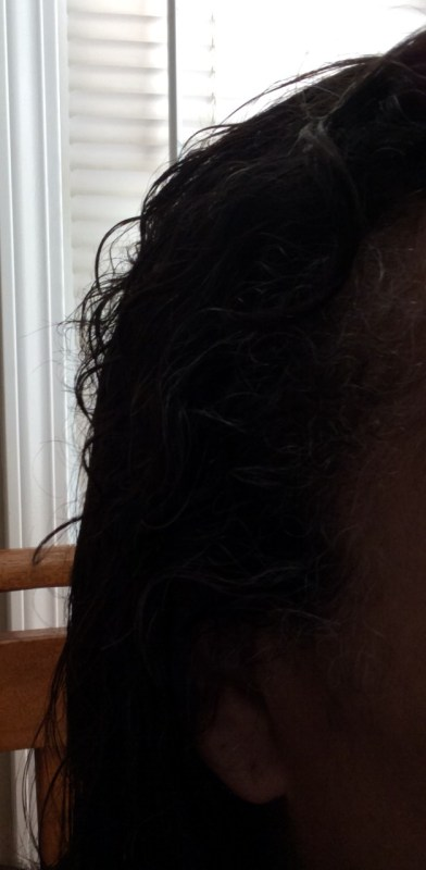 Wet hair with Sacred Tiara shampoo and conditioner