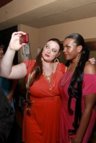 Plus size models Me'Shelle Williams and Jasmine Teer backstage for Kiss the Curves