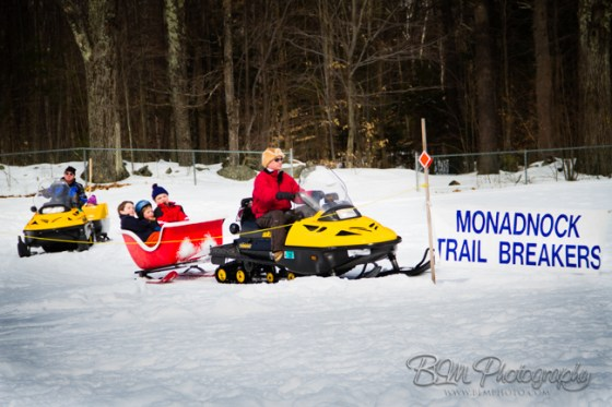 Don Weiss giving a Snowmobile ride