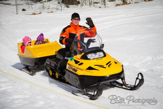 Kim Bergeron giving a snowmobile ride