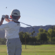 Kid practicing golf iron swing