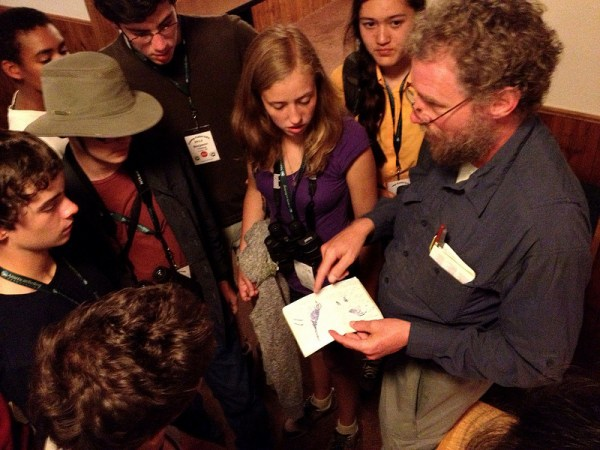 Steve Howell shows 2013 Camp Colorado campers his field notebooks from 25 years ago when he visited Colorado (and America) for the first time! (Photo by Jeff Bouton/Leica Sport Optics)