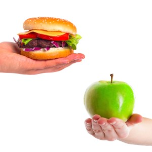 Choice between healthy apple and unhealthy hamburger
