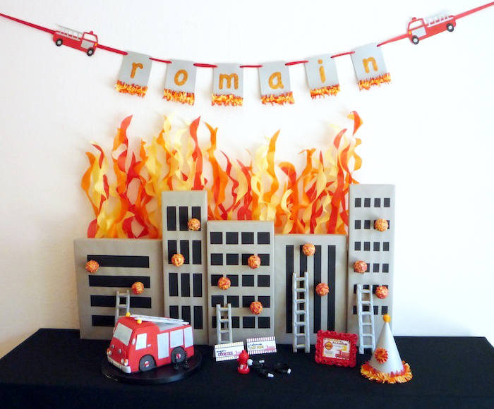 Fireman party Dessert Table Five Alarm Guest Dessert Feature {& Tissue Fire Backdrop Tutorial}