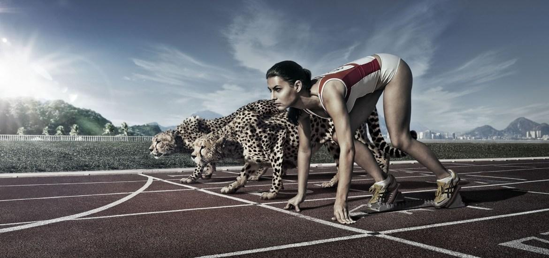 marathon_runner_girl_with_cheetah_on_race_start_line-wide