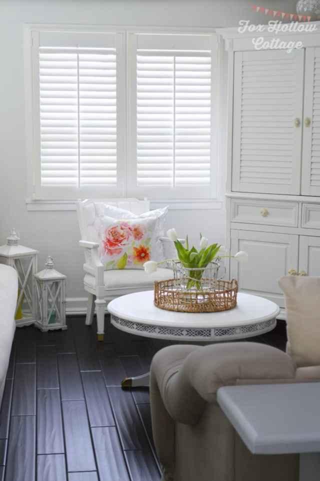 Cottage-Living-Room-White-Dark-Wood-Floors-Plantation-Shutters