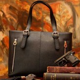 The Tote is available in bright pumpkin for fall or classic black. The large zippered main compartment offers numerous pockets and has access to the firearm sleeve. $249.