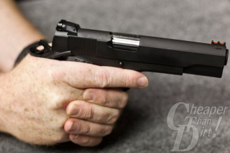 The trigger guard should rest between the first and second joint of your weak-side index finger.