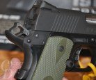 Picture shows a close-up of a black polymer-framed 1911.