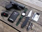 Picture shows a Glock 19, Kershaw knife with black handle and a Streamlight Microstream flashlight.