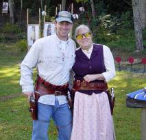 Couple dressed on Old West clothing with guns