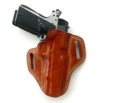 Semi-automatic pistol in leather holster