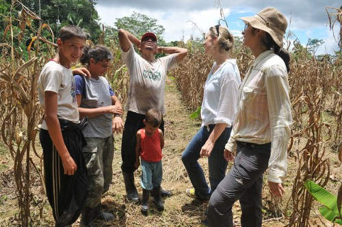 Kaline (R) speaking with farming family in Acre – staying with families is one of the pleasures of fieldwork, she says. Kate Evans/CIFOR