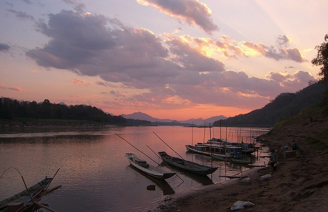 Sunset over the Mekong River, near Luang Prabang, Laos.