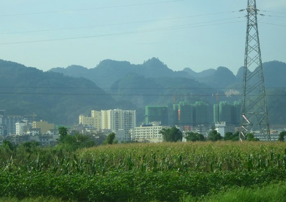 Rapid urbanization is encroaching on formerly remote areas in Libo County, Guizhou Province, China.