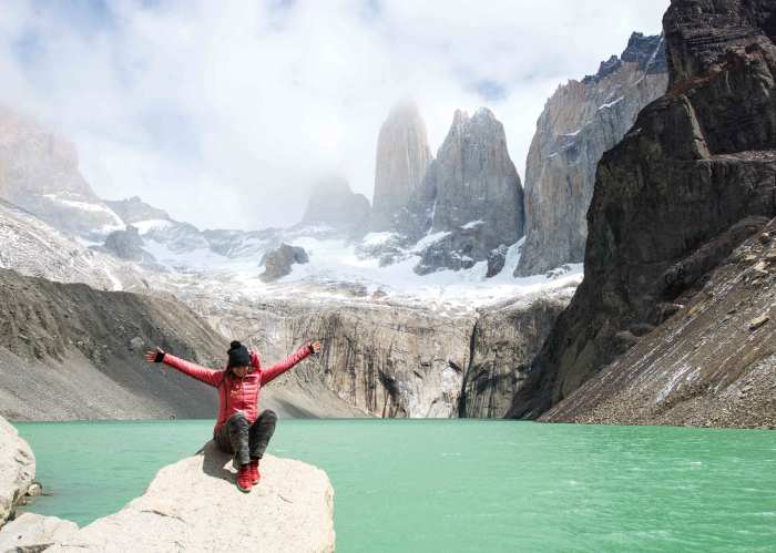 Director of Toughness Lauren Steele at Patagonia in Chile with arms spread wide.