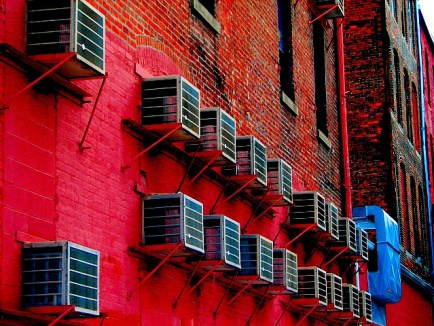 Air conditioners along the side of a building