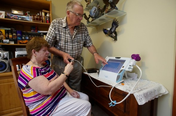 Janice from Bacchus Marsh, Victoria, measures her blood oxygen with the help of her husband and carer Bill. Her health stats are sent via a telehealth device to a local diabetes nurse who checks on her daily.