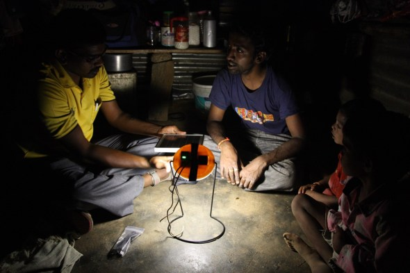 Helping a family get a solar-powered light for their home for the very first time.