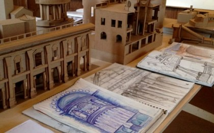 Table in studio with architectural drawings laid out