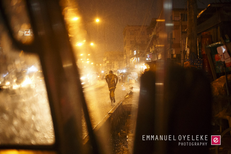 A man running to avoid being beaten too heavily by the torrential rain..