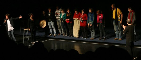 Audience members offer excess wardrobe to performers