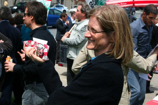 Nancy Wood gestures with a hot dog at a CBC union protest in May