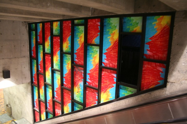 """""""Stained"""" glass windows inside - minus a missing pane"""