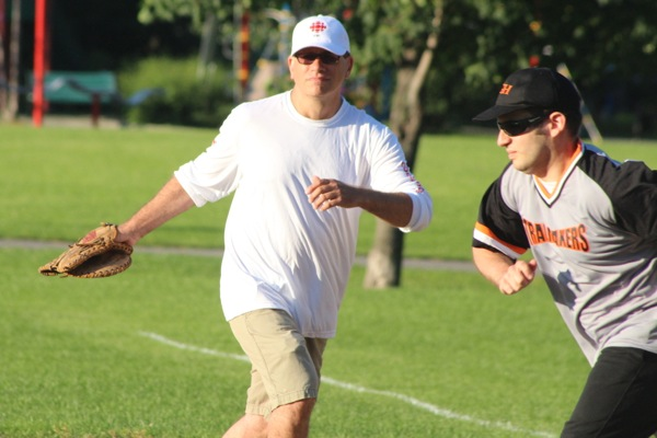 Shawn Apel can't stop a runner at first base.