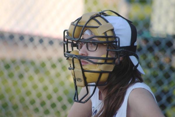 Sarah Leavitt gives her best I'll-cut-you face as she plays catcher.