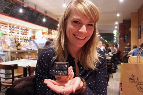 Katie Brioux shows off one of her stamps