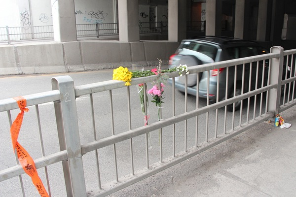 Flowers and other objects mark a memorial to a cyclist killed at a St-Denis underpass.
