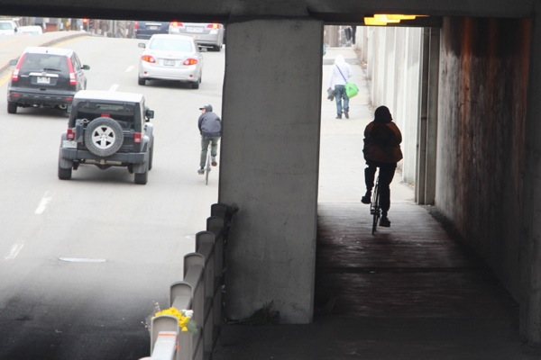 Which of these options is safer: Sharing a narrow lane with a car, or a narrow sidewalk with pedestrians?