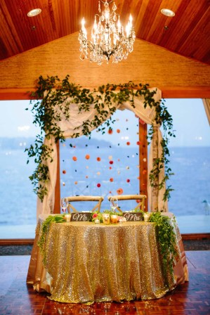 Flora Nova Design Seattle - Colorful Indian Wedding at the Edgewater Hotel. Draped Birch Ceremony Arch, with Flower Garland placed behind the Sweetheart Table